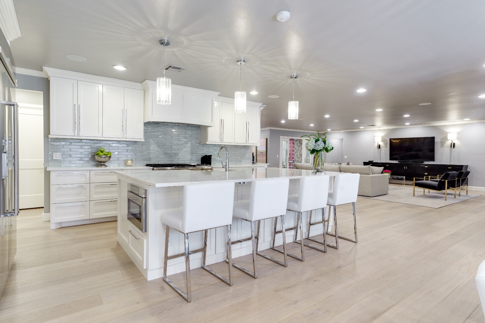 E Pendant Lights Above A Kitchen